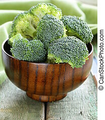 Fresh green broccoli on a wooden table