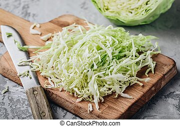 Fresh green cabbage cut. Sliced cabbage on the cutting board