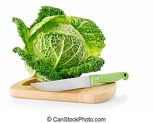 fresh green cabbage on board with knife