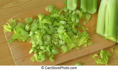 Fresh green celery on cutting board