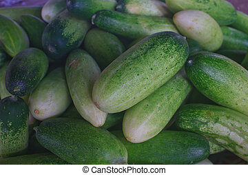 Fresh green cucumber collection on market
