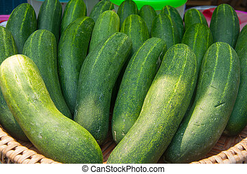 fresh green cucumber collection outdoor on market