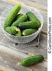 Fresh green cucumbers in a beautiful basket
