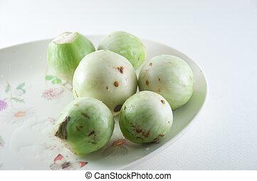 Fresh green eggplants