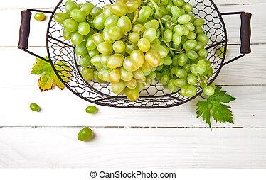 Fresh green grapes in vintage basket