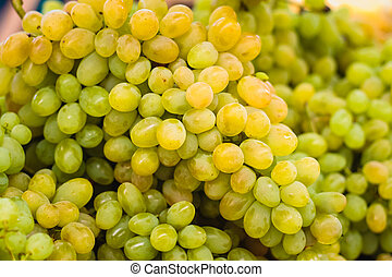 Fresh green grapes pile on the local market. Crop Background...