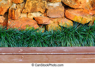 Fresh green grass on stone background