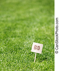 Fresh green grass with a Bio label