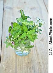 Fresh green herbs in the glass