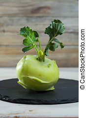 Fresh green kohlrabi cabbage with green leaves