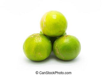 Fresh green limes on white