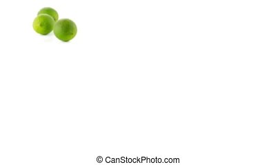 Fresh green limes isolated on white background, slide from...