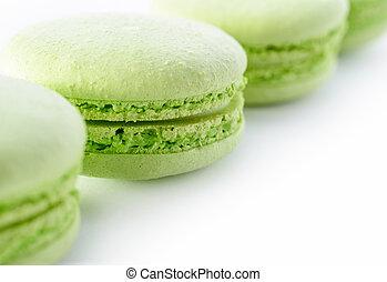 Food: fresh green macarons, close-up shot, food background or wallpaper