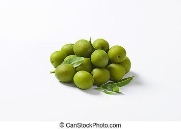 Fresh green olives on white background