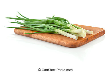 Fresh green onion on wooden board