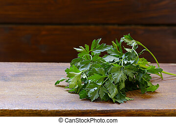 fresh green parsley on a wooden table