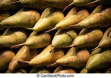 Fresh green Pear fruits on a fruit market for a healthy lifestyle