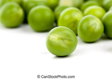 fresh green peas on a white background. Shallow depth of field