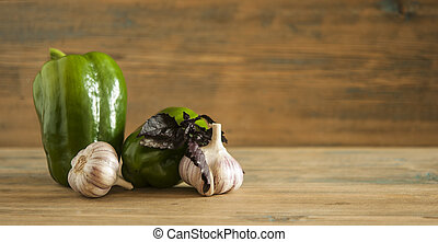 fresh green pepper on wooden background.