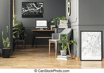 Fresh green plants in real photo of dark room interior with...