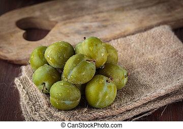 Fresh green plums