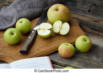 Fresh green rustic apples on a grey background