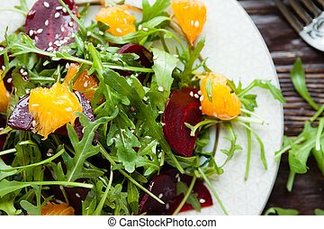 fresh green salad with arugula and beets
