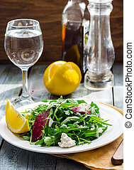Fresh green salad with beets, goat cheese and olive oil