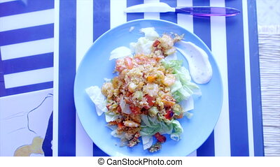 Fresh green salad with shrimps, couscous and spice