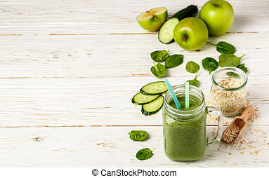 Fresh green smoothie from fruit and vegetables for a healthy lifestyle and ingredients