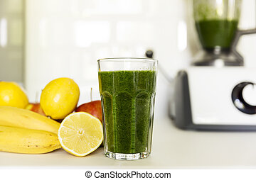 Fresh green smoothie from fruit and vegetables for a healthy lifestyle. Spinach, apple, banana, lemon.