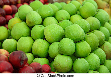 Fresh green sour apples in a market
