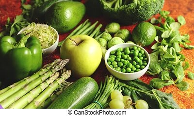 Fresh green vegetables and fruits assortment placed on a rusty metal