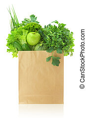 Fresh green vegetables and fruits in a paper grocery bag