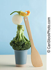 Fresh green vegetables, broccoli. The balance of the floating supply. Art concept of healthy nutrition.