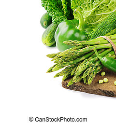 Fresh green vegetables on wooden cutting board