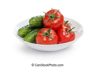 fresh greenhouse cucumbers and tomatoes in bowl