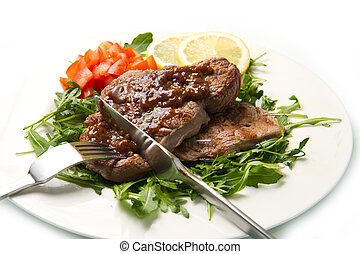 fresh grilled red meat with vegetables and sauce