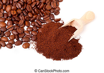 Fresh ground coffee with wooden spoon.