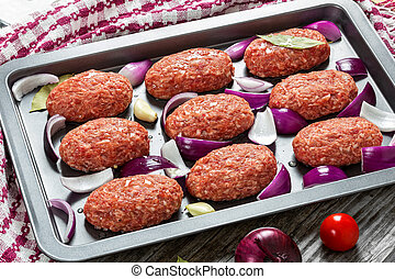 fresh ground raw meat cutlets with red onion