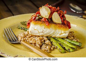 Fresh halibut filet on bed of farro - Dinner plate of fresh ...