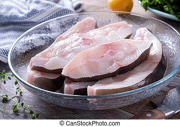 Fresh Halibut Steaks - Fresh halibut steaks in a glass bowl ...
