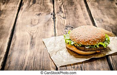 Fresh hamburger meat . On wooden background.
