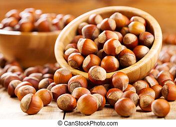 Fresh hazelnuts as background