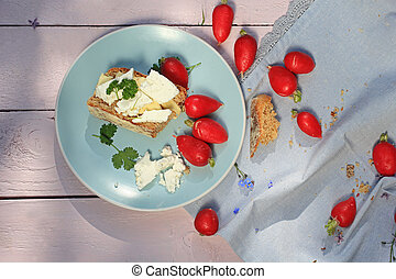 Fresh healthy breakfast, a slice of soda bread with butter and cottage cheese and red radish