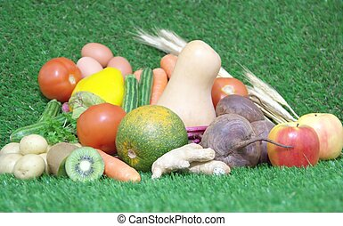 Fresh healthy food on green grass background