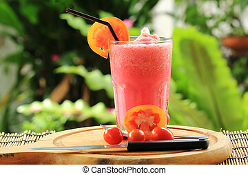 Healthy vegetable smoothie made of red ripe tomatoes smoothies