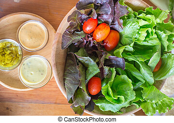 Fresh healthy salad on wooden table