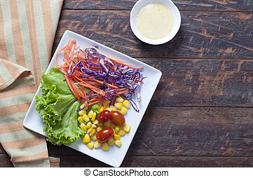 Fresh healthy salad on wooden table. View from above with copy space.