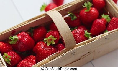 Fresh healthy strawberries in a wooden box on white ...
